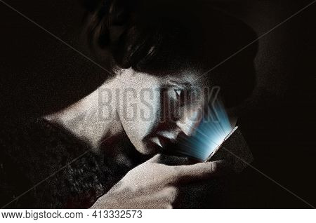 An Older Woman With A Vintage Look Peers At The Glowing Screen Of A Modern Cellular Mobile Phone. 3-