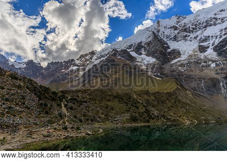 Panoramic View Of The Humantay Lake At The Base Of The Salkantay Mountain Range In Peru, With Its Co