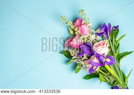 A Beautiful Bouquet Of Fresh Flowers On A Blue Pastel Background
