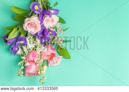 A Beautiful Bouquet Of Fresh Flowers On A Turquoise Pastel Background