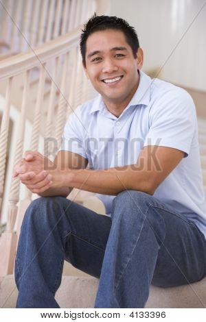 Man Sitting On Staircase Smiling