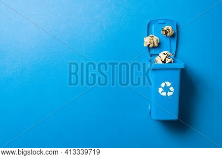 Trash Bin. Blue Dustbin For Recycle Paper Trash Isolated On White Background. Container For Disposal