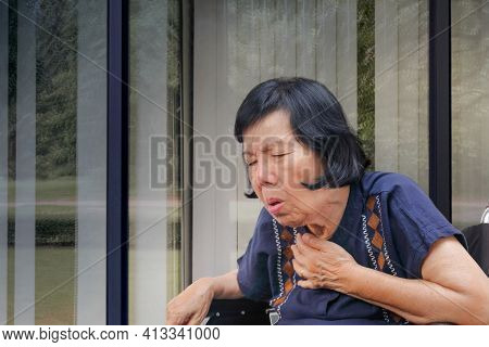 Close Up Elderly Woman Is Cough ,choke