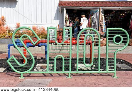 LONG BEACH, CALIFORNIA - 06 MAR 2020: Shop Sign - Bike Rack at Shoreline Village at Rainbow Harbor.