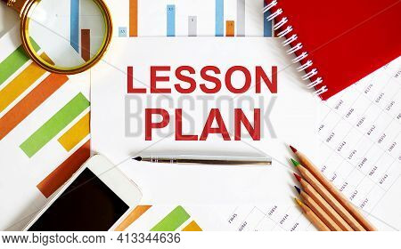 Text Lesson Plan On Notepad With Office Tools, Pen On Financial Report