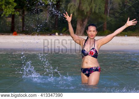 Woman Is Traveler Happy Play Water At Beach Koh Chang Thailand. Koh Chang Is Located In The Eastern