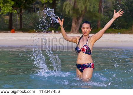 Woman Is Traveler Enjoy Play Water At Beach Koh Chang Thailand. Koh Chang Is Located In The Eastern
