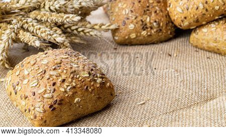 Bakery Products. Rye Bakery With Crusty Loaves And Crumbs. Fresh Loaf Of Rustic Traditional Bread Wi