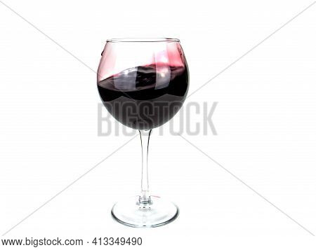 Glass Goblet With Red Wine Isolated On White Background. Splash Of Wine. Glass Goblet. Dishes For Al