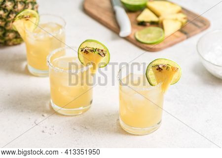 Pineapple Margarita Cocktail. Summer Boozy Refreshing Drink With Tequila, Pineapple In Glasses With