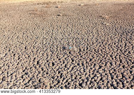 Lake Bottom Without Water After A Hot Season . Arid Climate , Drought Dirty Bottom After Drought . E