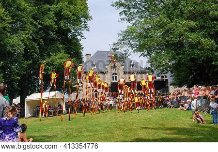 21 July, 2009, Vielsalm, Belgium. Stilt Walker Parade Show In Belgian National Day. In Costume With