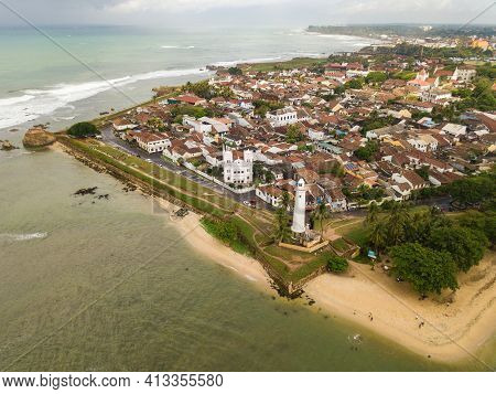 Aerial View Of Galle Lighthouse And Galle Fort Walls In The Bay Of Galle On The Southwest Coast Of S
