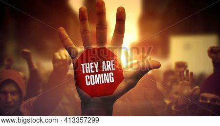They Are Coming - Close-up Of Raised Hand On Political Demonstration. Public Protest And Struggle Fo