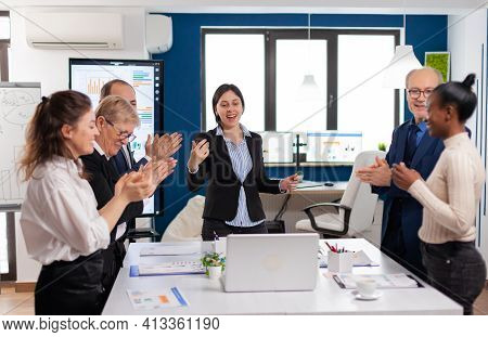 Happy Diverse Coworkers Applauding After Successful Presentation. Multiethnical Partners Coworkers C