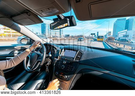 Happy Driver Inside Car At Sunset. Young Woman Have Fun Ride Trip Travel On Road In Winter Sunny Day