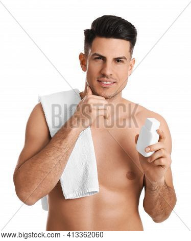 Handsome Man With Stubble Holding Post Shave Lotion On White Background
