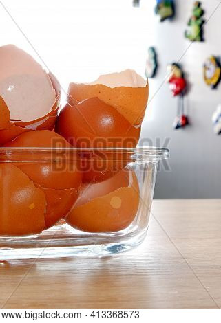 Eggshells On The Kitchen Background. Natural Background. The Concept Of Nutrition. Eggshells Are A S