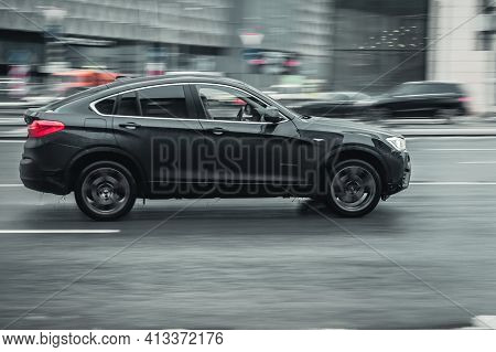 Moscow, Russia - January 2021: Bmw X4 Compact Luxury Crossover Suv Rides Through The City On Wet Sli