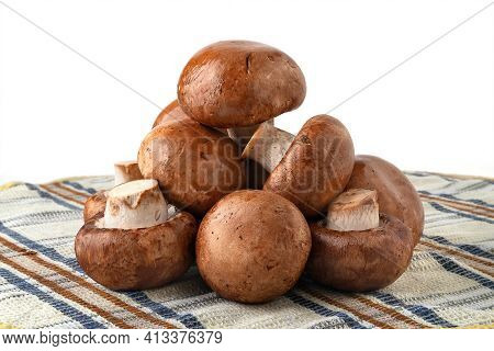 Champignon Mushrooms On A Towel. Brown Champignons Isolated On White. A Bunch Of Mushrooms. Natural