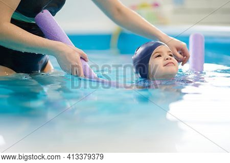 Active Child Swimming  In Pool