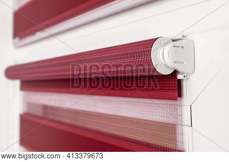Color Fabric Roller Blind On The Top Of The Window. Focus On The Swing Mechanism Of The Blinds. Moun