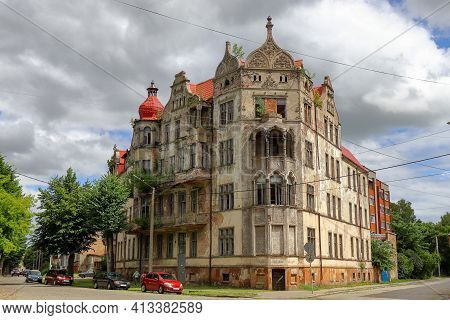 An Old Historic Abandoned House With Turrets And Decorative Ornaments On The Facade. One Of The Main