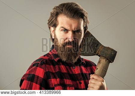 Bearded Man With Axe. Cut Hair With Ax. Male Hairdresser Or Barbershop. Brutal Butcher In Shirt. Lum