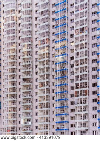 A Large Number Of Windows And Balconies On Building Facade. Apartment Block. Residental Building. Pr