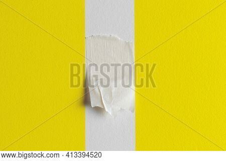 Remains Of Protective Paper Adhesive Tape On A Yellow Painted Wall With An Unpainted Strip. Protecti