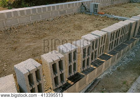Hollow  Heavy Concrete Blocks For Construction Of Stone Walls Building. Masonry Walls Made Of Heavy