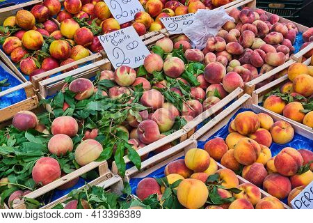 Differents Kinds Of Peaches And Nectarines For Sale At A Market