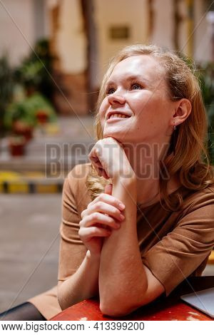 Portrait Of Beautiful Pensive Woman Grins, Grinning, Eyes Glistening, Young Caucasian Female Person