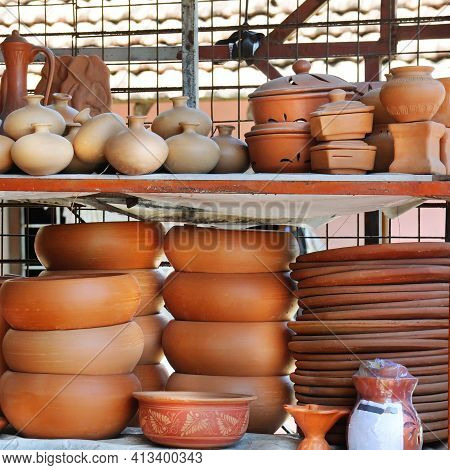 Shelves With Ceramic Dishware In Pottery Workshop. Traditional Sri Lankan Earthenware Pottery.