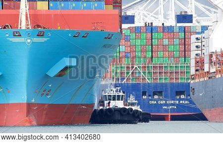 Oakland, Ca - Mar 10, 2021: Tugboats Are Small Yet Powerful For Their Size. Multiple Tugboats Assist
