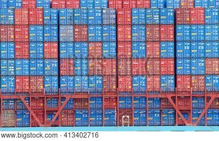 Oakland, Ca - Mar 10, 2021: Shipping Containers Stacked On Cargo Ship Maersk Evora. The Average Cont