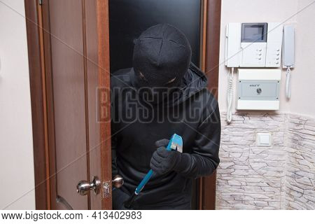 Apartment Theft.the Thief Tries To Break Into The Apartment And Steal Things.