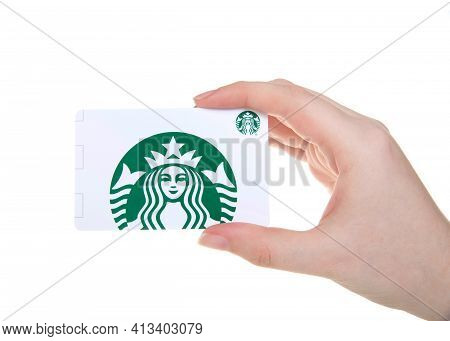 Alameda, Ca - Mar 7, 2021: Young Caucasian Hand Holding Starbucks Gift Card Isolated On White. Starb