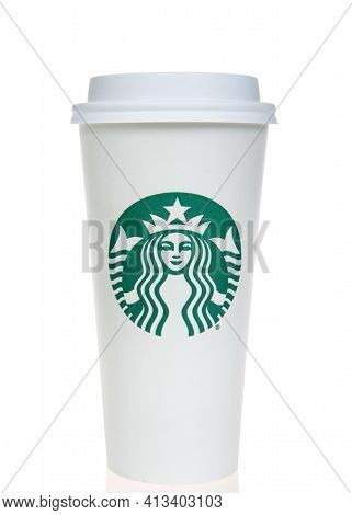 Alameda, Ca - Mar 7, 2021: Starbucks White Cup, Venti Large, With Green Logo Sitting On Reflective S