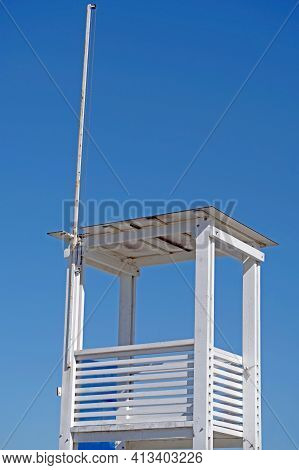 Lifeguard Chair Isolated On A Background Sky