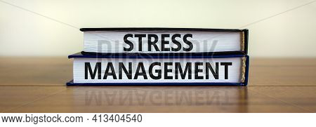 Stress Management Symbol. Books With Words 'stress Management'. Beautiful Wooden Table, White Backgr