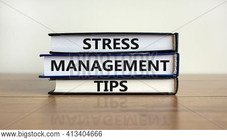 Stress Management Tips Symbol. Books With Words 'stress Management Tips'. Beautiful Wooden Table, Wh