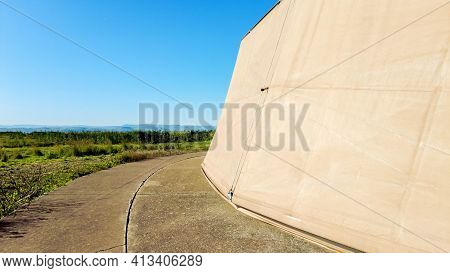 A Large Dome Shaped, Thick Weatherproof Material, Aircraft Hangar. The Hangar Located On Hard Standi