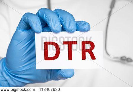 Doctor Holding A Card With Text Dtr Deep Tendon Reflexes, Medical Concept