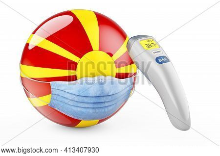 Macedonian Flag With Medical Mask And Infrared Electronic Thermometer. Pandemic In Macedonia Concept