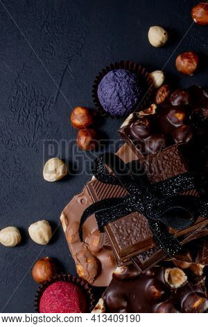 Chocolate Bar, Crushed Pieces Of Dark Chocolate And Nuts. Praline Chocolate Sweets