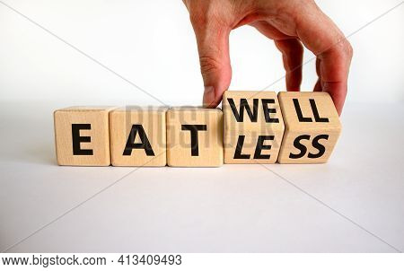 Eat Well Or Eat Less Symbol. Businessman Turns Cubes And Changes Words 'eat Less' To 'eat Well'. Bea