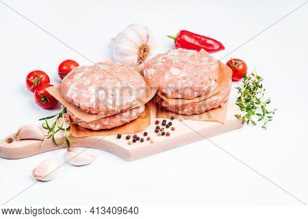 Raw Chicken Hamburger On A White Background In A Rosemary Branch. Instant Meat. Grilled Hamburgers.r
