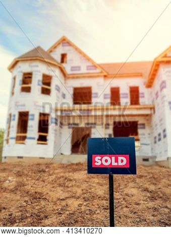 Sold sign in front of house under construction