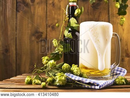 Beer. Pint Of Beer Close Up On A Wooden Background. Cold Craft Light Beer In A Glass With Water Drop